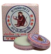 White Monkey Holding Peach Balm