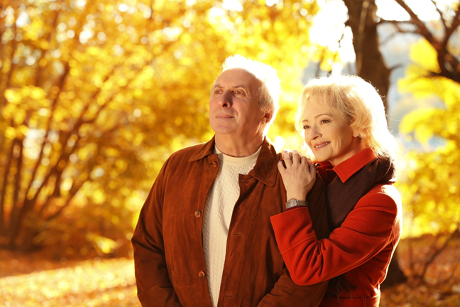 Lovely mature couple in autumn park