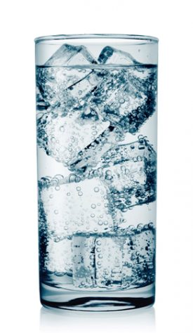 Glass of water with ice cubes isolated on white background